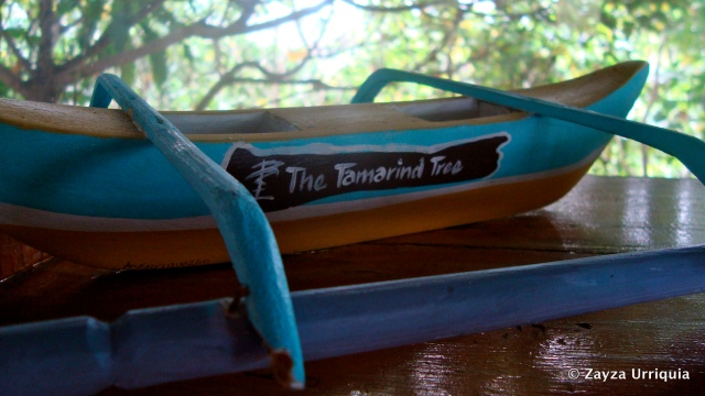 miniature boat with the resort's logo